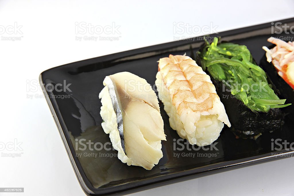Sushi made from seafood on Black dish. royalty-free stock photo