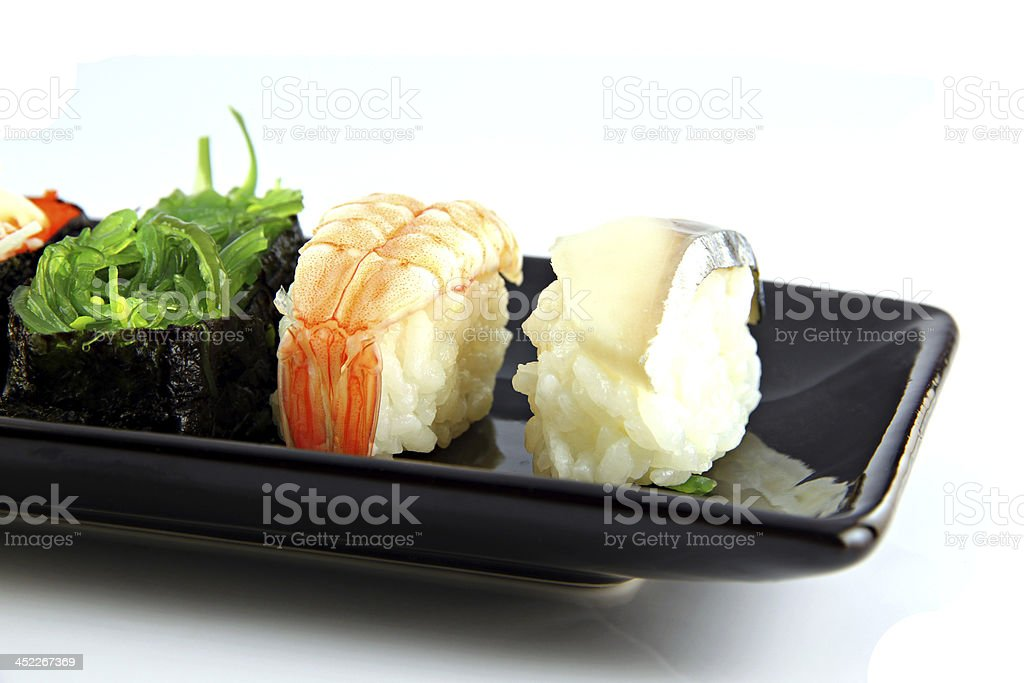 Sushi made from seafood on white background. royalty-free stock photo