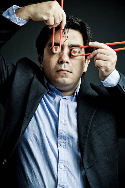 寿司の男性 - ローフード ストックフォトと画像