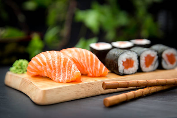 sushi nigiri with fresh salmon and maki roll - japanese food stock photos and pictures