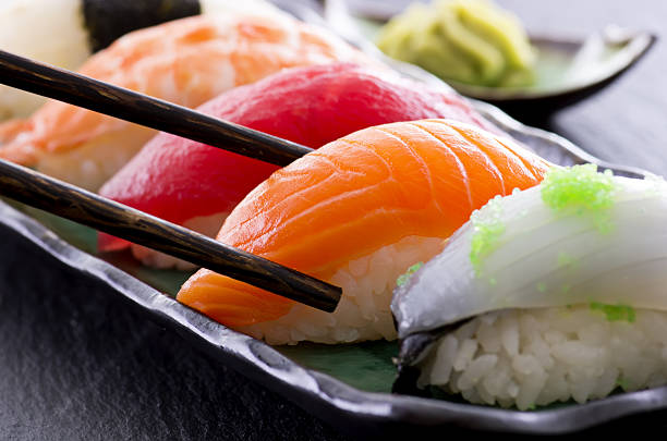 sushi on a plate - sushi stock photos and pictures
