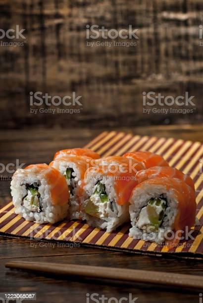 Sushi on a white plate sushi roll with sauce and spices on a black picture id1223068087?b=1&k=6&m=1223068087&s=612x612&h=olr8smsl1p8xcnl3izs1ke8www2ppiq5g9djxhysyda=