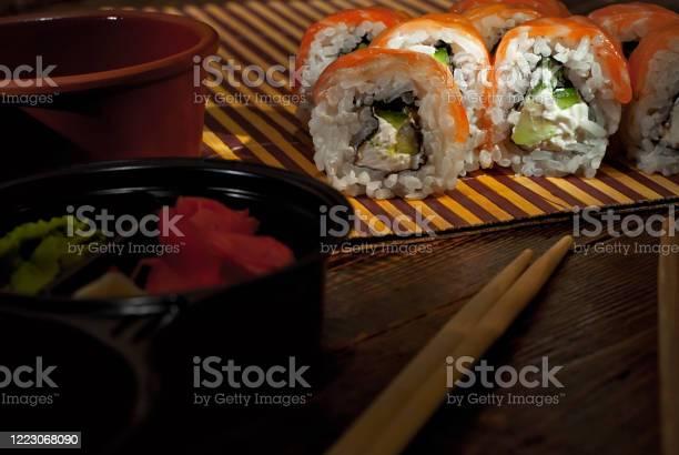 Sushi on a white plate sushi roll with sauce and spices on a black picture id1223068090?b=1&k=6&m=1223068090&s=612x612&h=m3imscg0vuok9l1uub2w9jesaf2ymvpqdqx1ilzng28=