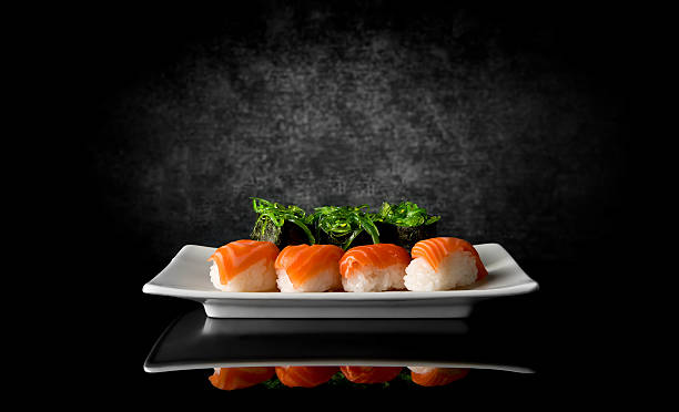 sushi on black - japanese food stock photos and pictures