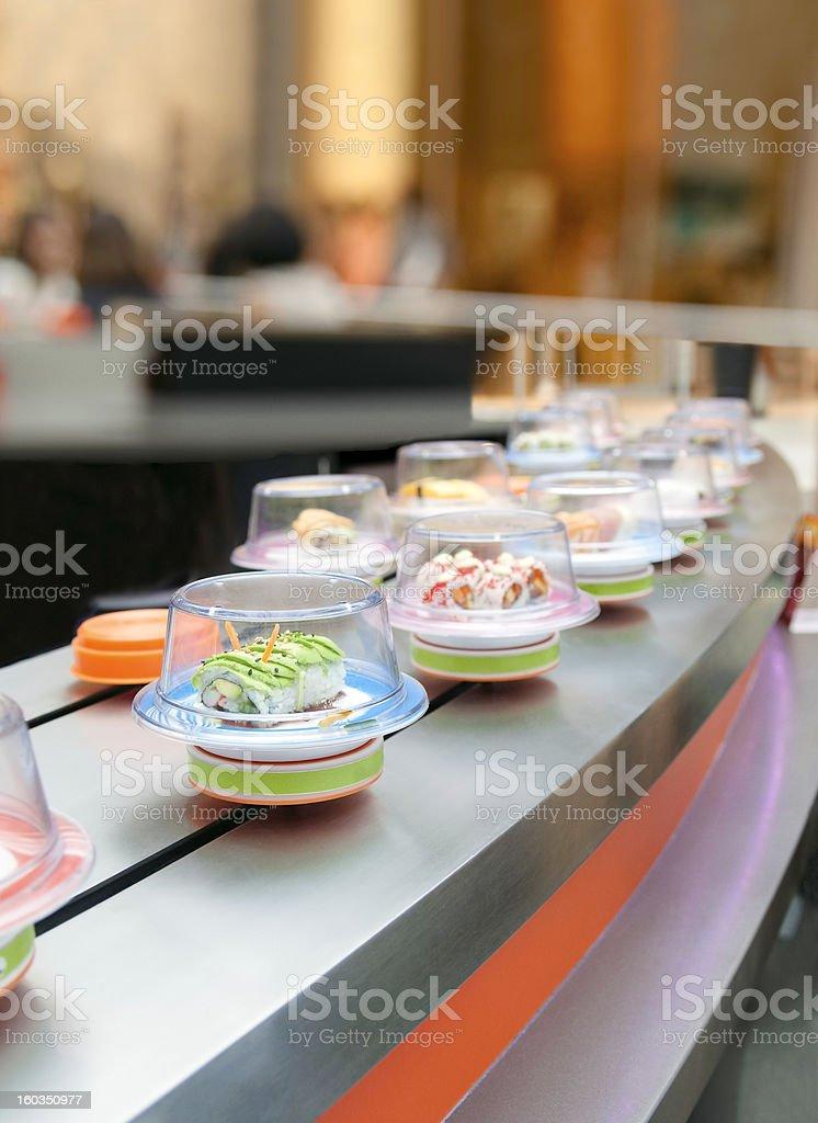 Sushi on conveyor royalty-free stock photo