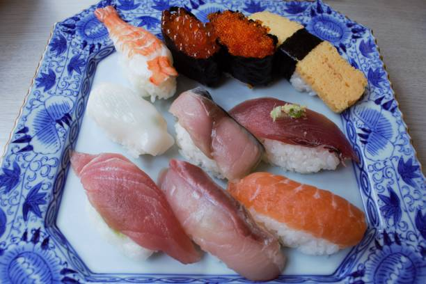 Sushi on plate at Tsukiji fish market in central Tokyo, Japan stock photo