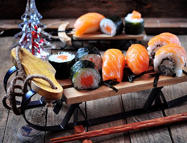 sushi on small sleigh Christmas background, selective focus. stock photo