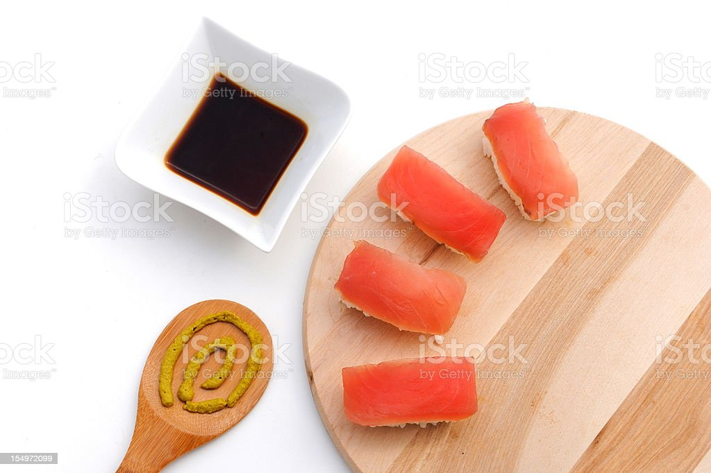 sushi on wooden board with soy sauce and wasabi royalty-free stock photo
