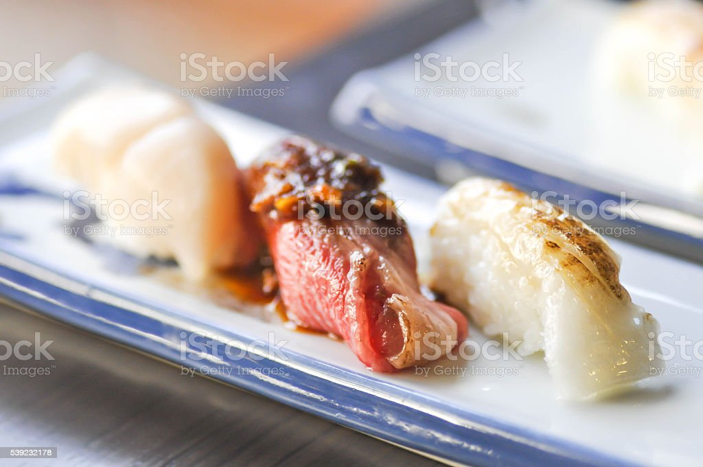 sushi or rice with grilled beef and grilled fish topping royalty-free stock photo