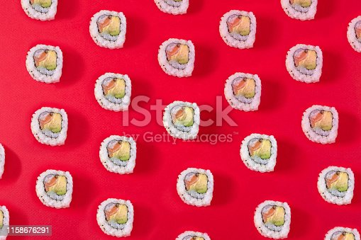 istock Sushi Pattern on red background 1158676291