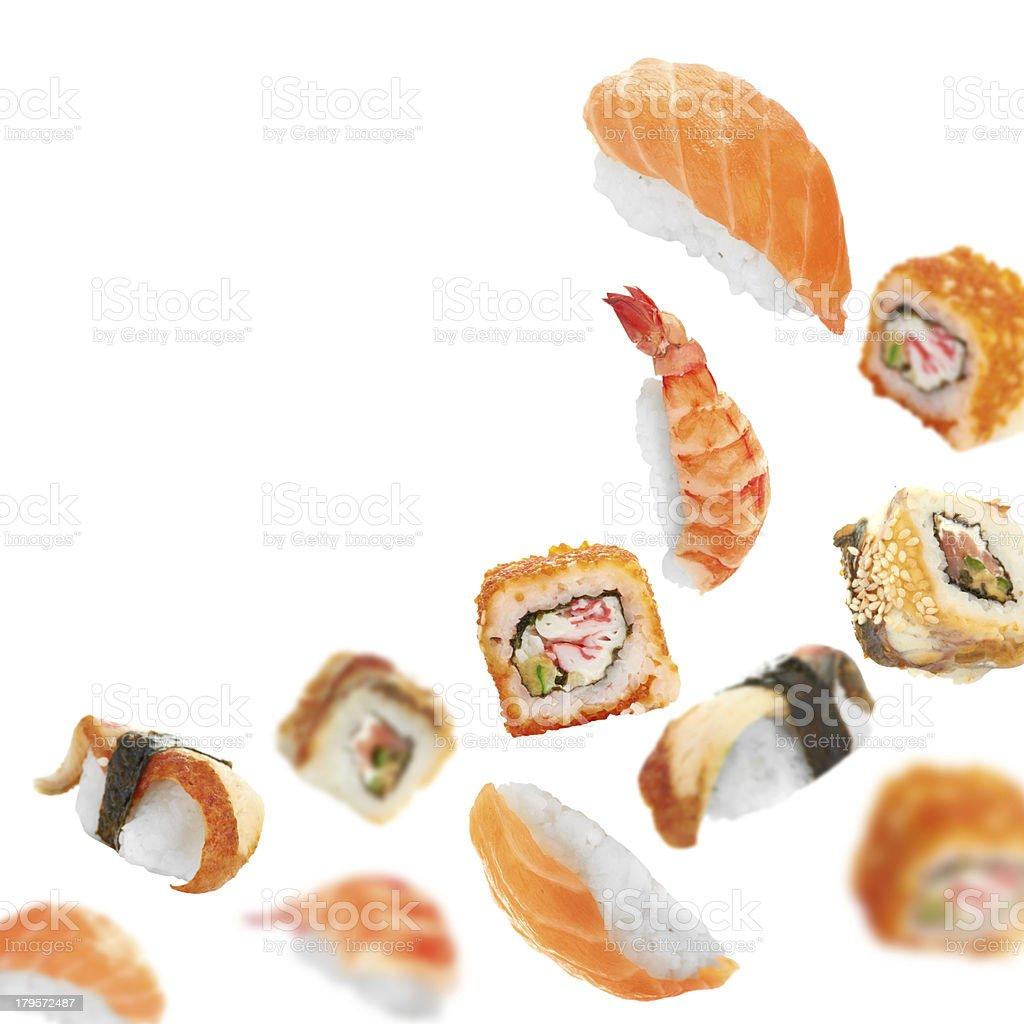 Sushi pieces flying on white background royalty-free stock photo