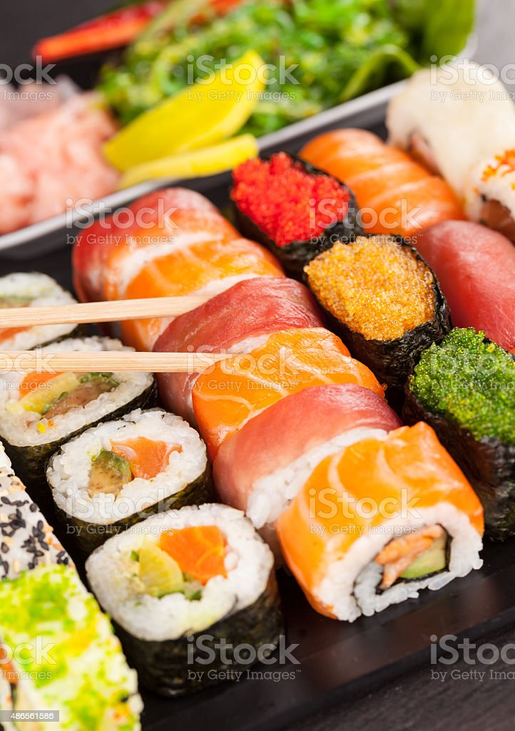 sushi pieces with chopsticks stock photo