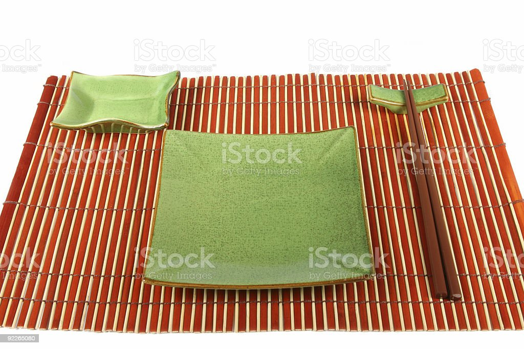 Sushi plate and chopsticks on bamboo mat royalty-free stock photo