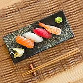 A close up of a nigiri sushi plate.