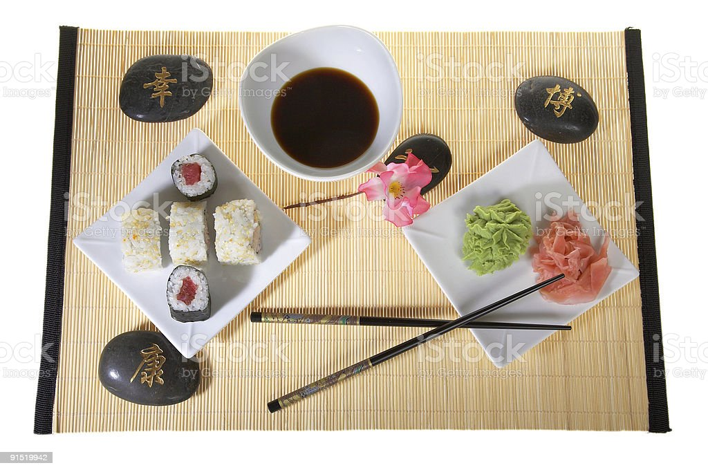Sushi plate with chopsticks and flower royalty-free stock photo