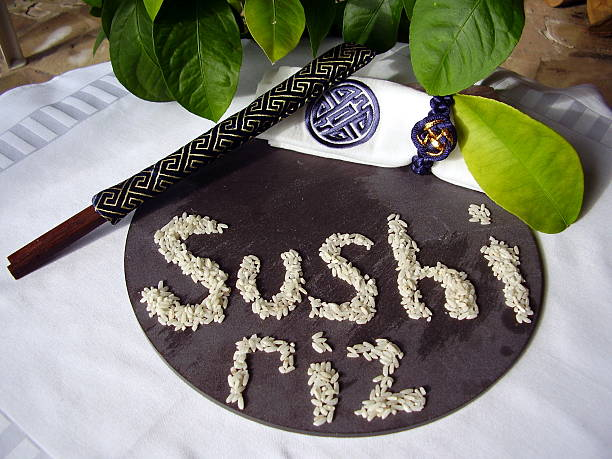 Sushi Riz Slate plate with Sushi Riz spelt out in rice riz stock pictures, royalty-free photos & images
