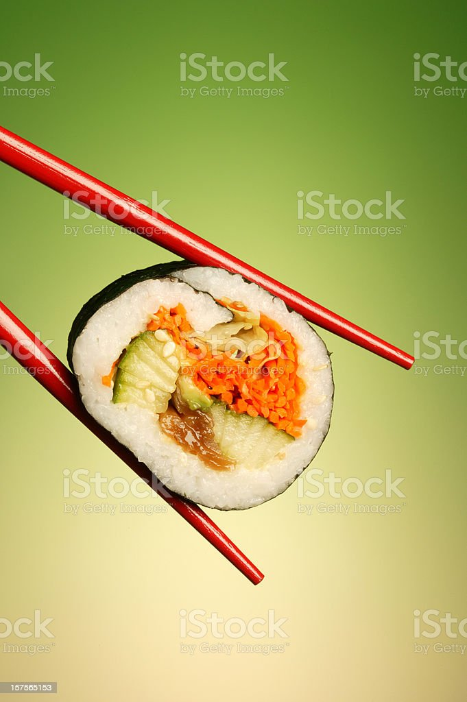 sushi roll in red chopstick royalty-free stock photo