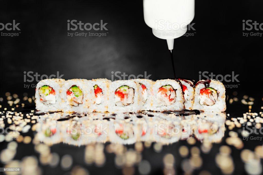 Sushi Roll Philadelphia Unagi On Black Background Made Of