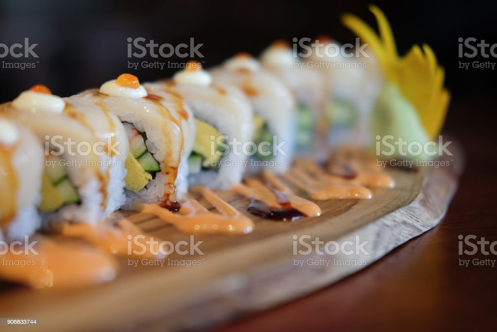 Sushi roll set served on a wooden tray stock photo