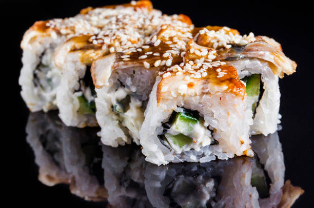 sushi roll sets on the black background stock photo