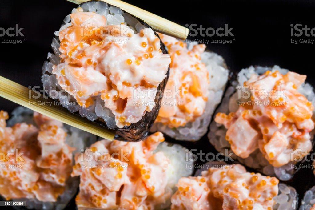 壽司卷套上黑色背景 免版稅 stock photo