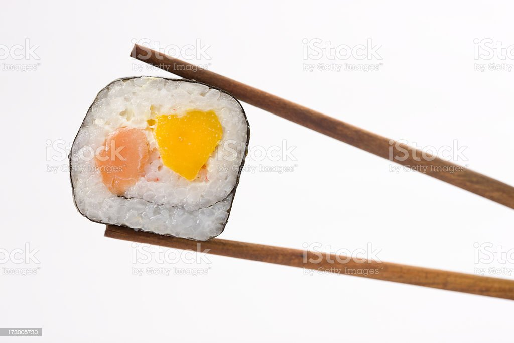 Sushi roll with chopstick royalty-free stock photo