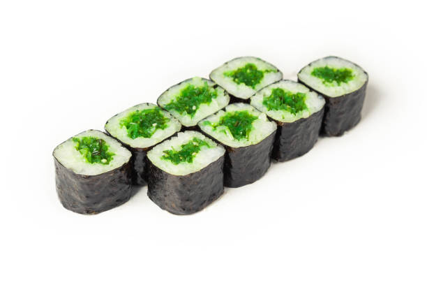 Sushi roll with chuka on a white plate, classic Japanese sushi. Traditional Japanese food with maki. Delicious pieces of sushi. For the restaurant menu. copyspace stock photo