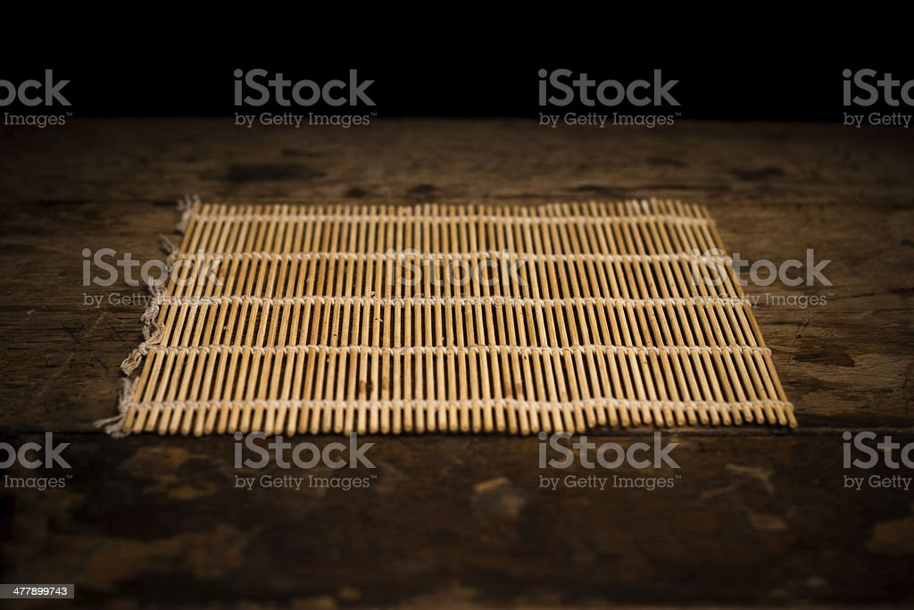 Sushi rolling mat on wood surface stock photo