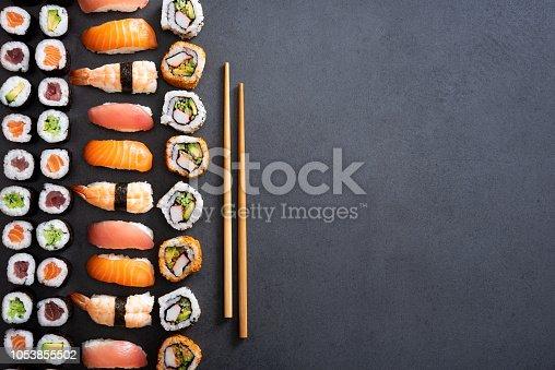 istock Sushi rolls and nigiri background 1053855502