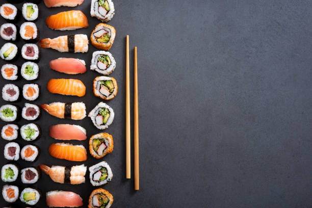 sushi rolls and nigiri background - sushi stock pictures, royalty-free photos & images