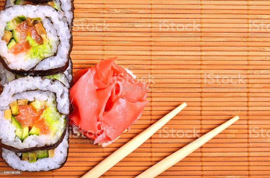 Sushi Rolls Ginger And Chopstick On Bamboo Mat Stock Photo