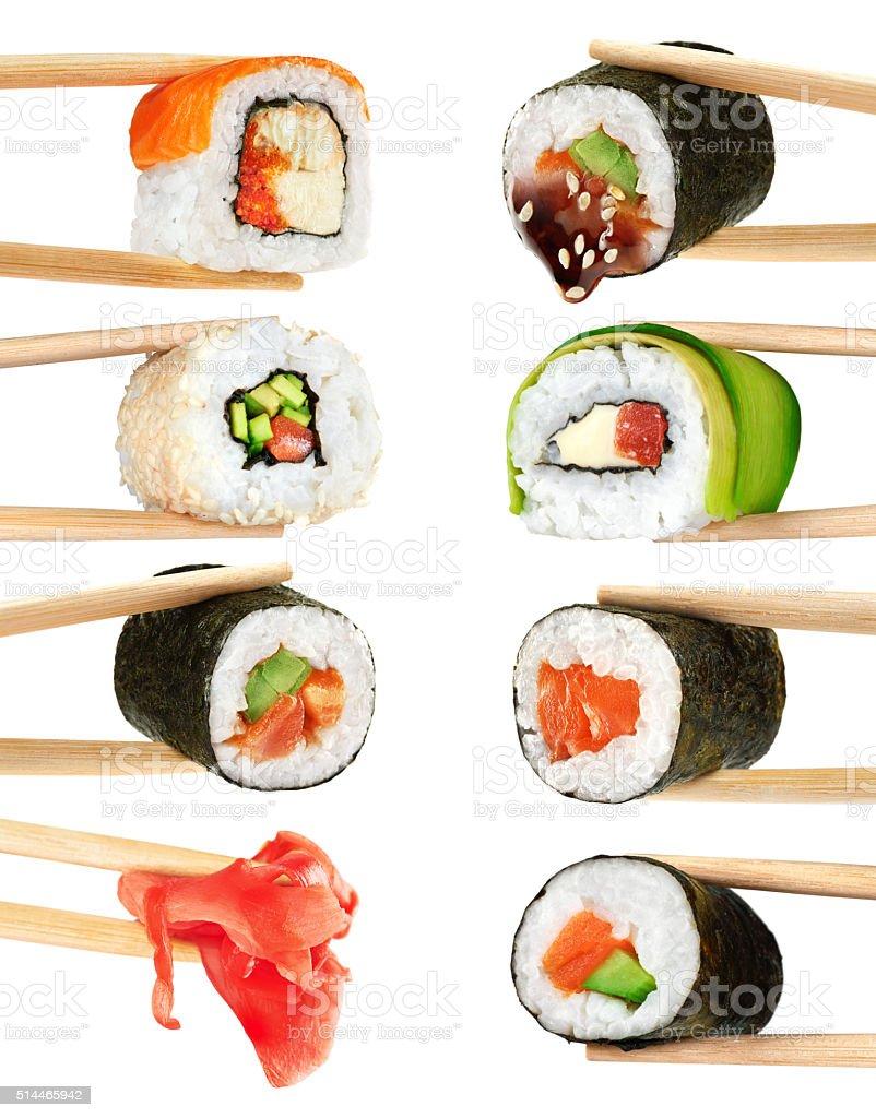 Sushi rolls isolated on white background. Chopsticks. stock photo