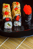 two sushi chopsticks with empty bamboo mat or wood plate on stone Background Top view with copy stace.