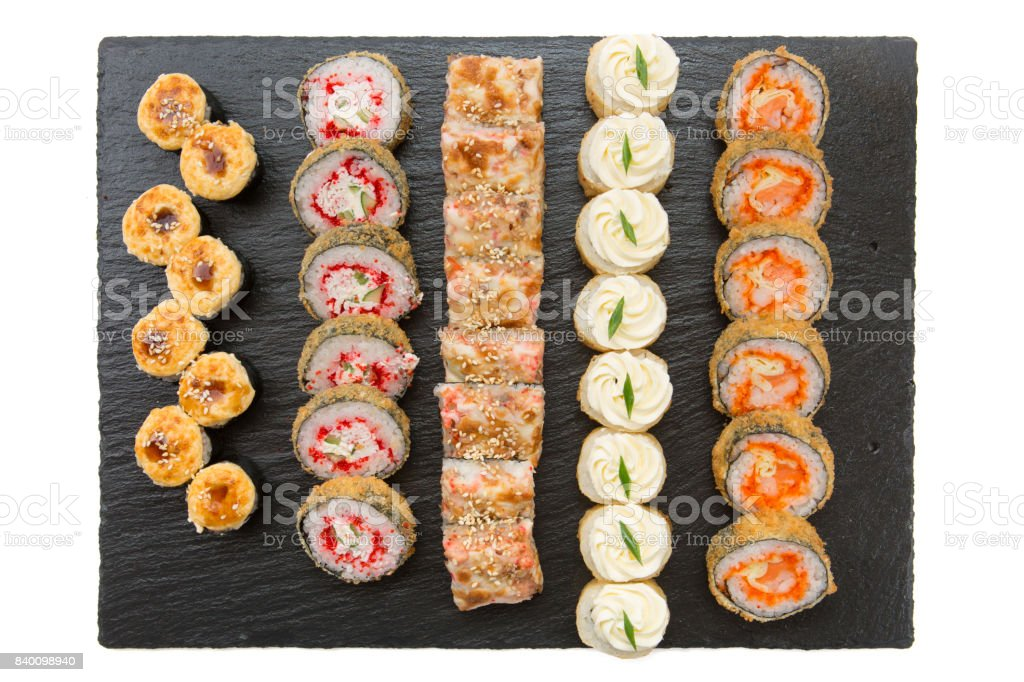 Sushi rolls on a black background. Japanese food restaurant. Top view stock photo