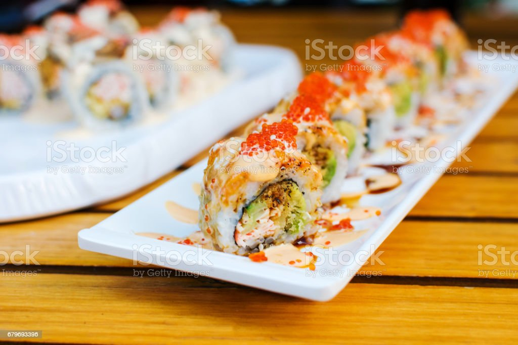 Sushi rolls on a plate in a restaurant stock photo