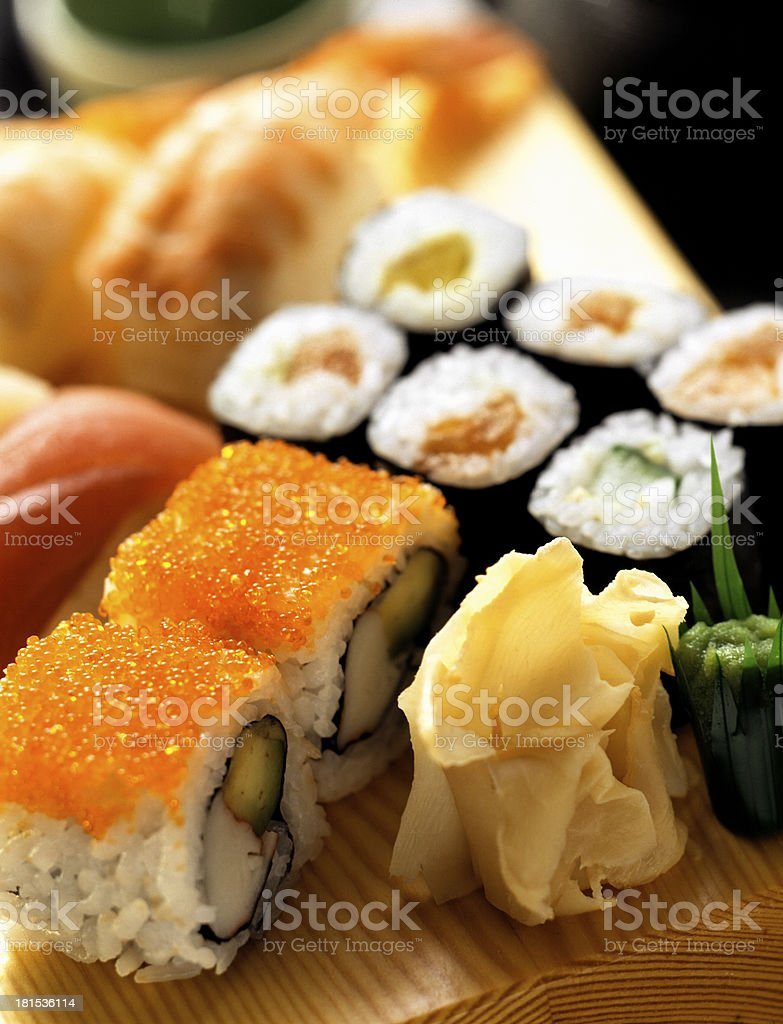 sushi rolls on a traditional oriental sectioned dish royalty-free stock photo