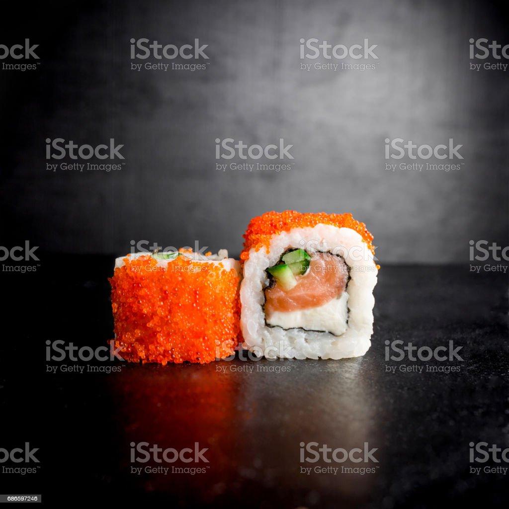 Sushi rolls on black background. Japanese food photo libre de droits