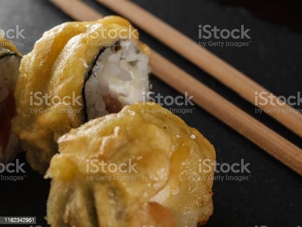 Sushi rolls on gray stone slate on wood background picture id1162342951?b=1&k=6&m=1162342951&s=612x612&h=hdyu3sljl s5hwwawstyhlbt3ai3u1iewutjpwj gpg=