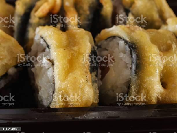 Sushi rolls on gray stone slate on wood background picture id1162343612?b=1&k=6&m=1162343612&s=612x612&h=clyyi0eaw8tyaon9rej4b40wqk83cduxelnxx3gamom=