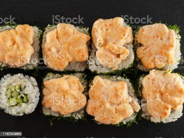 Sushi rolls on gray stone slate on wood background picture id1162343663?b=1&k=6&m=1162343663&s=612x612&h=ps qtmjtcn58fkqgut7k4jqaz3yonfw2ygogmfayude=