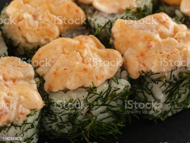 Sushi rolls on gray stone slate on wood background picture id1162343675?b=1&k=6&m=1162343675&s=612x612&h=bdistxocyaacbmerecbk0nmdn1opvyzc7o8bmfojgbc=