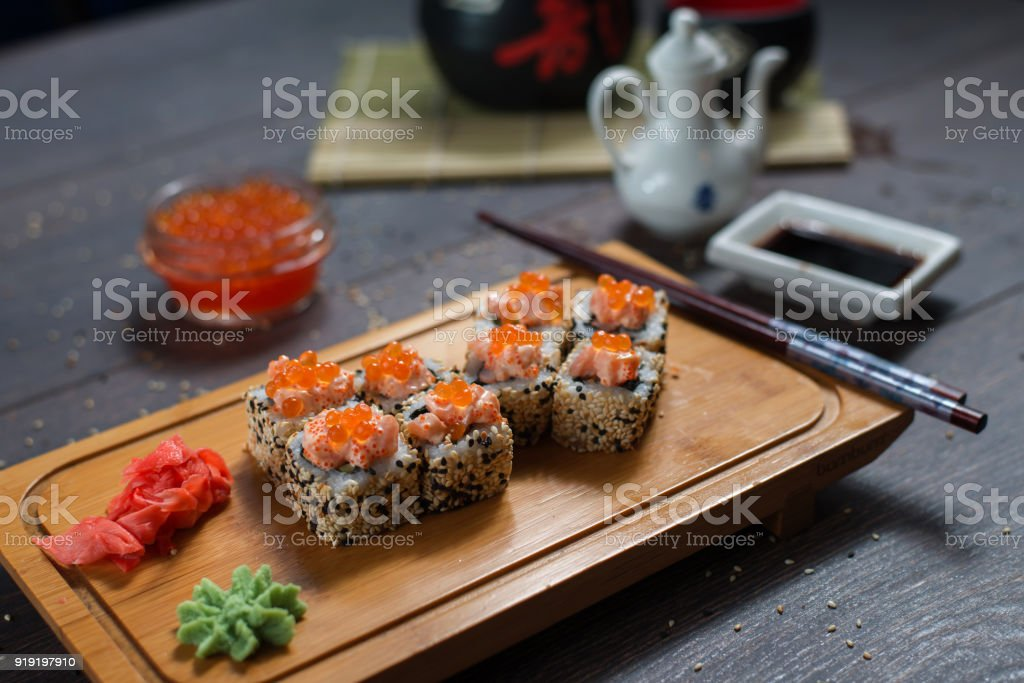Sushi Rolls Served On A Wooden Plate In A Restaurant Sushi