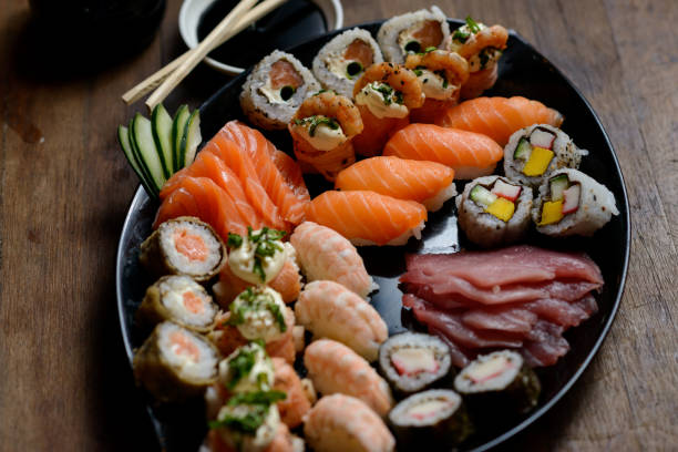 sushi sashimi boat seafood ship - japanese food stock photos and pictures