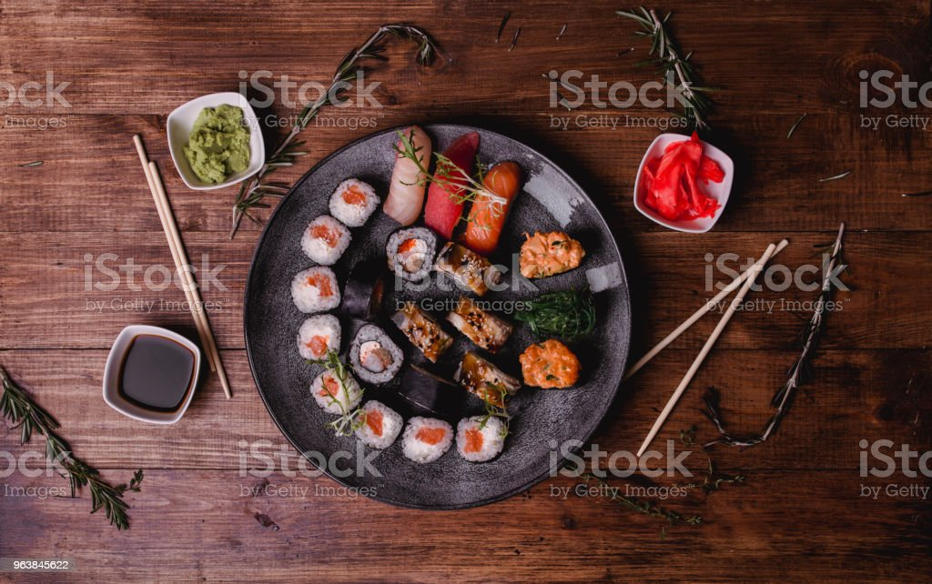 Sushi set nigiri and rolls served on brown wooden table background. Top view food photography - Royalty-free Asia Stock Photo