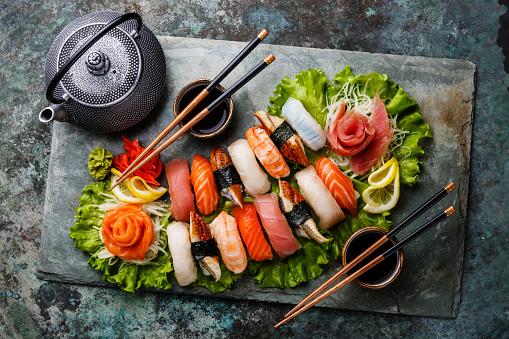 Sushi Set Nigiri And Sashimi With Tea Stock Photo - Download Image Now