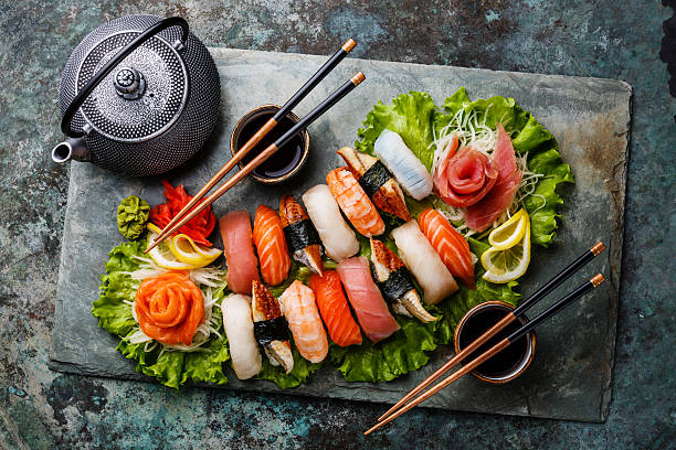 sushi set nigiri and sashimi with tea - japanese food stock photos and pictures