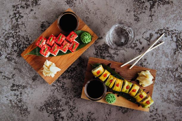 Sushi Set nigiri and sushi rolls with tea served on gray stone slate stock photo