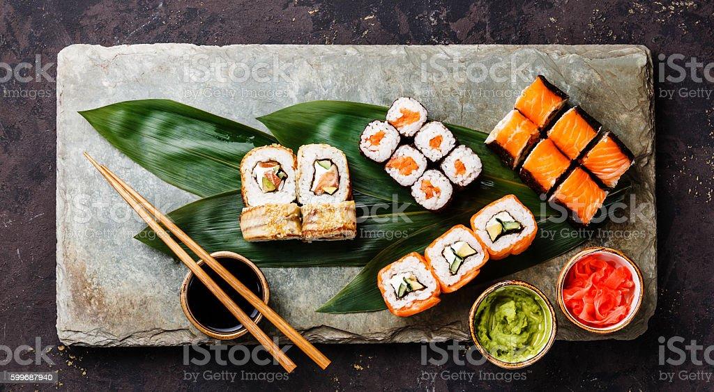 Sushi Set rolls on bamboo green leaf stock photo