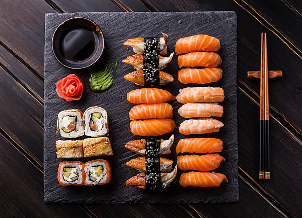 sushi set sashimi and sushi rolls - japanese food stock photos and pictures