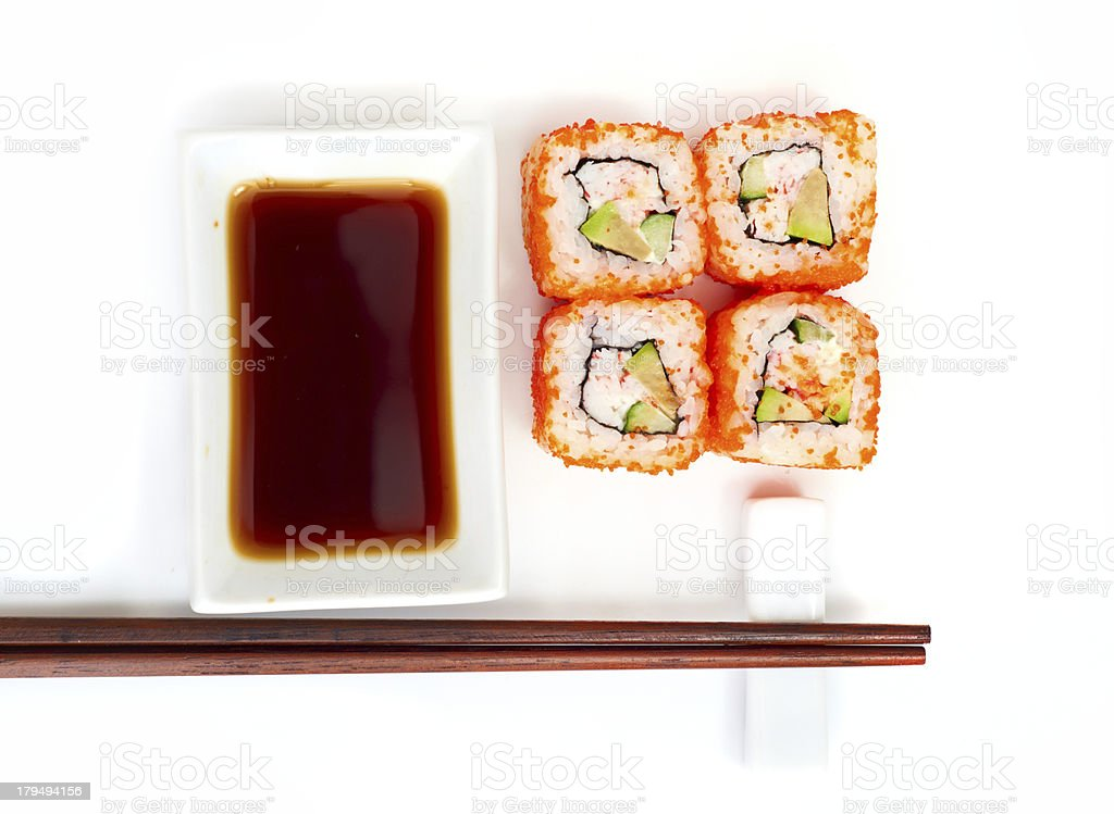 Sushi with chopsticks isolated over white background royalty-free stock photo